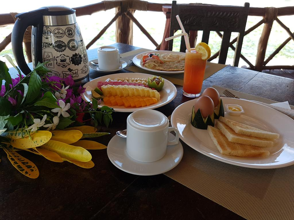 Queen of Sheba Beach Lodge breakfast by Party Trip Travel Agency