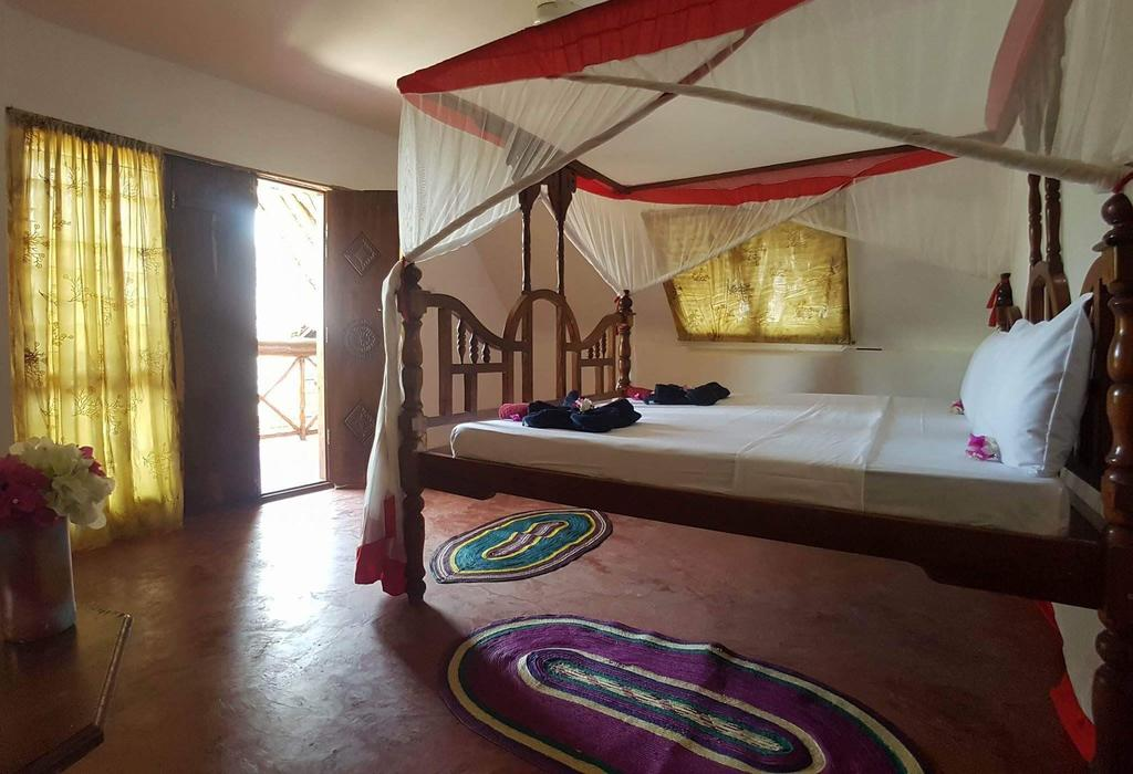 Queen of Sheba Beach Lodge room by Party Trip Travel Agency
