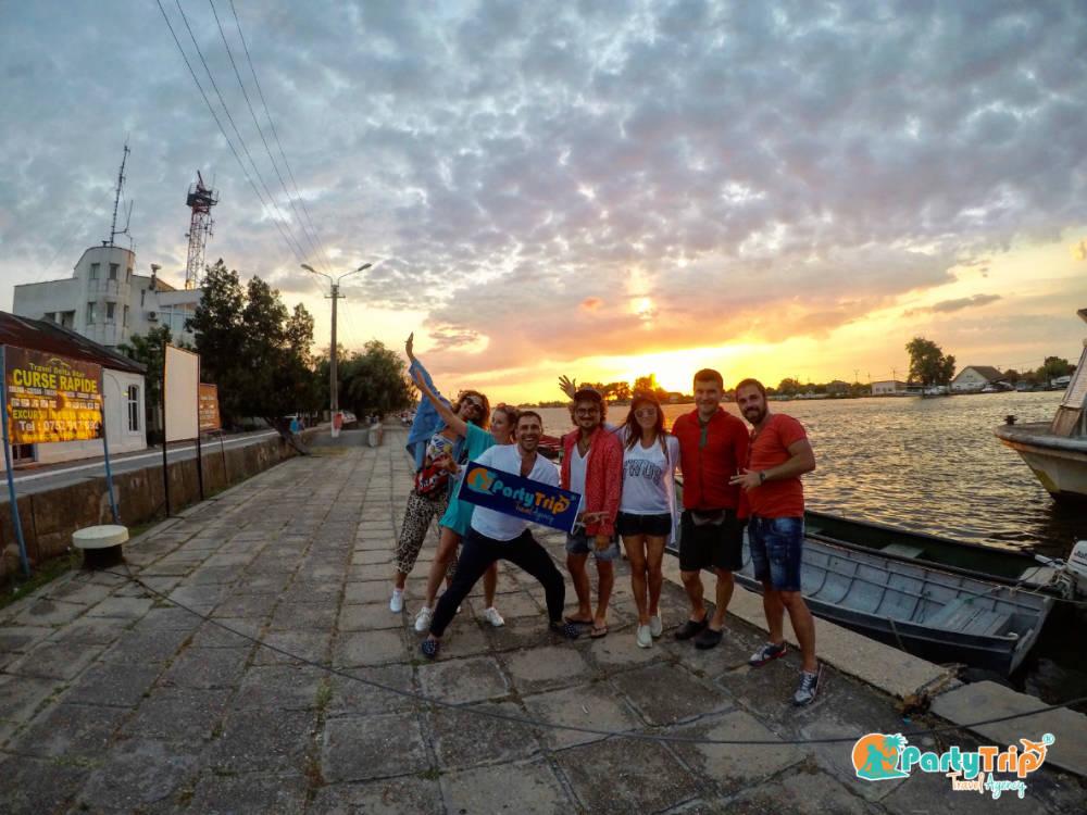 Apus de soare in Sulina, Delta Dunarii by Party Trip
